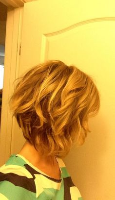 Swing Bob Hairstyle Back View | Asymmetrical Wavy Bob: Long Bob Haircut for Summer / Via