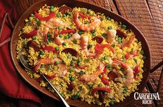 Celebrate authentic ingredients and traditional culture with a delicious Paella recipe using Mahatma Saffron Yellow Rice Mix, juicy sausage, plump shrimp, and roasted red pepper strips. Brown Rice And Quinoa Recipe, Yellow Rice Recipes, Easy Rice Recipes, Healthy Holiday Recipes, Cajun Recipes, Cooking Recipes, Dutch Recipes, Paella Rice Recipe, Gourmet