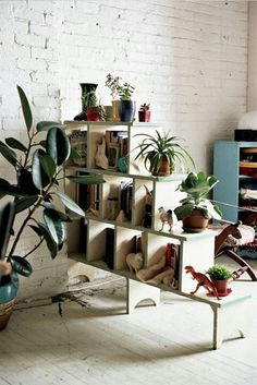 cube shelf room divider- Love this idea to divide our basement- play room/office, movie side