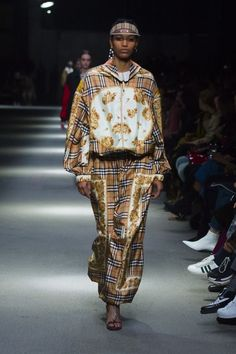 A Vintage check and archive scarf print jumpsuit with a 1983 check visor and T-bar sandals #BurberryShow #LFW