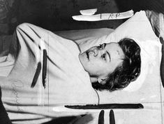 Ardith Lennander, who had been flogged by her husband as part of a religious cleansing ritual, lying in bed in an apparent state of shock, her eyes open and her lips scarred by bloody cuts.  She would die the next day - October 18, 1951.  (Culled from Murder Has a Public Face)