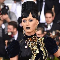 #METGALA HAIR  MAKEUP INSPIRATION: #KatyPerry certainly took a creative risk with those nude brows and stern beehive but isn't that what the big night is for?? Sound off in the comments  | props to @chrisappleton1 on hair