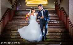 Bride and groom walking down the Ground Stairs at the Joondalup Resort