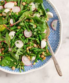 Bright Spring Green Salad - A fresh spring picnic salad made with blanched asparagus, peas, chickpeas, and fresh herbs. Tossed with a basil dressing.