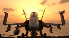 F-18 Hornet at rest on carrier.