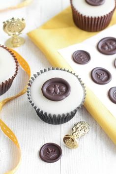 Chocolate Wax Seals on Poured Fondant Honey Cupcakes....maybe for cake slices for wedding???
