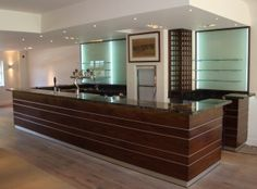 Walnut bar with horizontal aluminium inlays and granite bar top. Hotel Reception Desk, Office Storage, Surrey, Joinery, Office Furniture, Granite, Lockers, Commercial, Bar