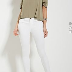 Forever 21 white jeans White skinny jeans from the Contemporary line at Forever 21. Never worn, they are too big for me Forever 21 Jeans Skinny