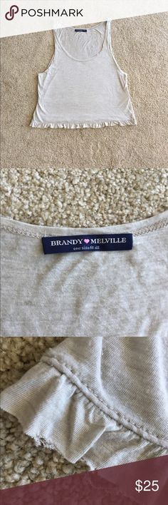 Brandy Melville beige crop top Brandy Melville beige crop top. Gently used in good condition. No trades. Bottom edge is unfinished as pictured. Small mark as pictured. Please ask all questions before purchasing and use the offer button, thanks! Brandy Melville Tops Crop Tops