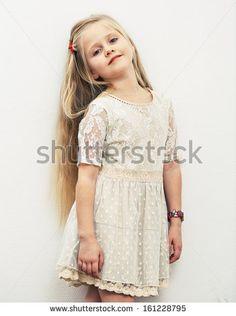 Smiling girl fashion portrait. Child model. - stock photo