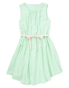 Spring party perfect! Allover dots and neon pick-stitched ribbon sash add super sweet fashion to a breezy dress.