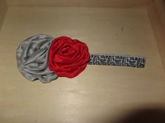 Red/silver rolled satin rosette on damask elastic