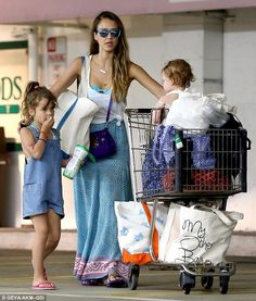Minding the little ones: Jessica Alba had her hands full on Sunday as she juggled a shopping buggy and her two daughters in Beverly Hills
