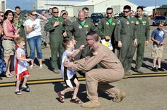 Tech. Sgt. David Hendrickson is greeted by his sons, Aiden and Karsten, May 13, 2001, at Little Rock Air Force Base, Ark. Sergeant Hendrickson is assigned to the 61st Airlift Squadron. (U.S. Air Force photo/Staff Sgt. Chris Willis)