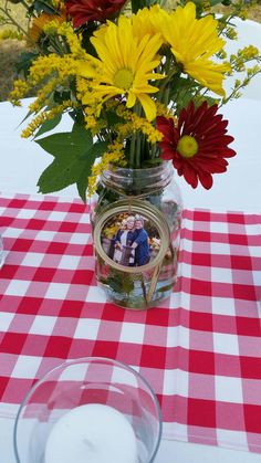 There are methods to upgrade your mason jars. Coloring a mason jar is simple, and spraying is even simpler. Painting a mason jar is a simple course of action. The best thing about mason jars is they are essentially a… Continue Reading → Picture Centerpieces, Wedding Centerpieces Mason Jars, Flower Centerpieces, Wedding Decorations, Table Decorations, Graduation Table Centerpieces, Centerpiece Ideas, Rehearsal Dinner Centerpieces, Mason Jars For Weddings