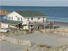 """Enjoy an unforgettable beach vacation in this oceanfront Carova 4x4 home with panoramic views of the Atlantic Ocean. """"A Beachfront Paradise"""" is ..."""