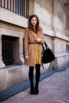 belted camel coat + mustard dress + black leggings and shoes. Classic but also modern.