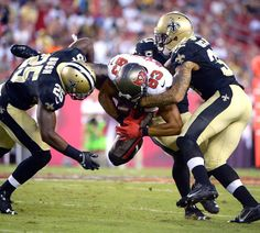 Buccaneers wide receiver Vincent Jackson finds himself between Saints defenders. (Phelan M. Ebenhack/AP) More Bucs punishing themselves Broncos, Jets, Nfl Football, Football Helmets, Vincent Jackson, Sports Personality, Wide Receiver, National Football League, Defenders