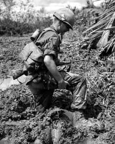 U.S. soldier struggles through the mud in the Mekong Delta - Vietnam War