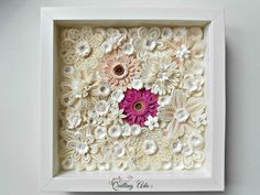 Quilled flowers wall hanging