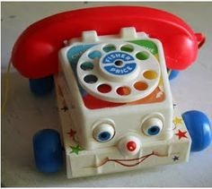Fisher Price Telephone.  We had one exactly like this that all three girls shared.  The eyes rolled up and down.