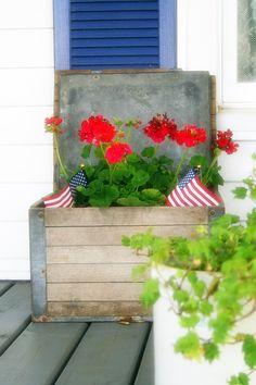 A patriotic display in a vintage oak milk crate.