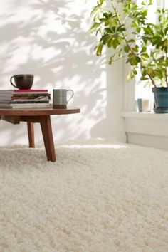 Soft, warm white shag rug is the standard bearer or Scandinavian decor.