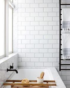 Remember this beauty by @lloydhartleyarchitects? A timely reminder that TILES totally maketh' the BATHROOM :) :) Photo by @jacshooter via @homestolovenz! Team DS. X #designstuff #bathroom #bathroomdesign #bathroominspiration #marble #blacktapware #subwaytiles #whiteonwhite #scandistyle #blacktowelrack #interiors #interiorinspiration #newzealand #bevelledtiles #bevelledsubwaytile #auckland #newzealandhomes #nzinteriordesign #nzhomes