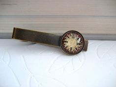 Compass/map tie clip