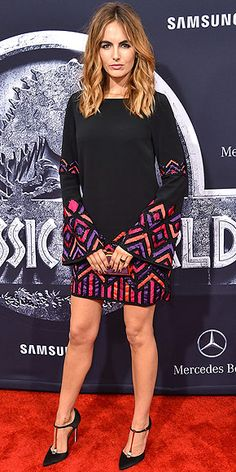 Last Night's Look: Love It or Leave It? Vote Now! | CAMILLA BELLE | in a bell-sleeve dress baring a bold pattern, and a coordinated manicure and clutch at the premiere of Jurassic World in Hollywood.