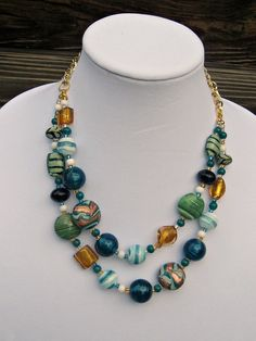 Lampwork Green, Gold and White Necklace - Two Strand Bead Necklace - Lampwork Bead Necklace - Holiday Necklace. $49.00, via Etsy.