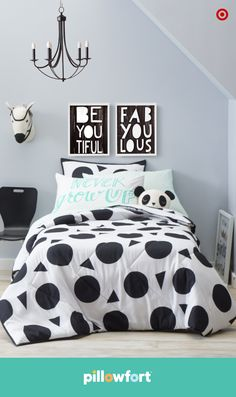"""Black and white can still be wild, especially when it's chic and graphic. Pillowfort's Discovery Den collection lets kids find their own style—maybe it's adding color, their favorite animals in the form of a zebra wall mount or a cute panda pillow or fun accessories with sayings like, """"never grow up."""" Let the games begin!"""