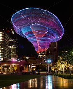 Artist Janet Echelman reshapes urban airspace with monumental, fluidly moving sculpture that responds to environmental forces including wind, water, and sunlight. This sculpture is suspended in downtown Phoenix, AZ. Land Art, Janet Echelman, Kunst Party, Instalation Art, Urbane Kunst, Large Artwork, Electric Forest, Artistic Installation, Sound Installation