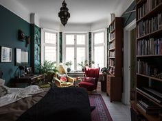 Bedroom with vintage touches and green walls