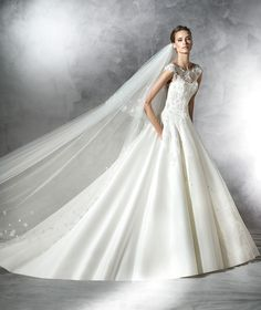 Satin dress, tulle, lace and gemstones