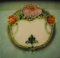 This beautiful, very stylised Art Nouveau floral wreath design featuring a camelia and two tulips appears on a tile of a mahogany and marble washstand.  Private collection.