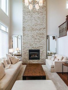A floor to ceiling fireplace really pops and gives any room a wow factor! #RafteryrRealEstate #bostonrealestate #bostonmetro #greater #boston #home #newhome #dreamhome #openhouse #fireplace #livingroom #space #minimalliving #interiordesign #condo #apartment #homesearch #homeiswheretheheartis