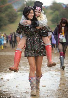 Sasha Atkinson, gives best pal Paris Graham-Jones, a piggyback through the mud at . Best Pal, Enjoy The Sunshine, Rain, Hipster, Music Festivals, Mud, Graham, Funny, Fashion