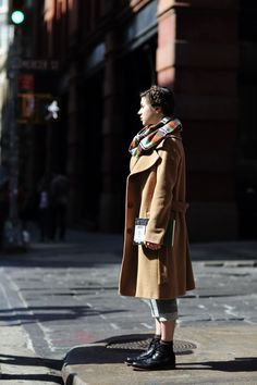 via The Sartorialist / long belted coat + plaid scarf / transitional weather / cold spring