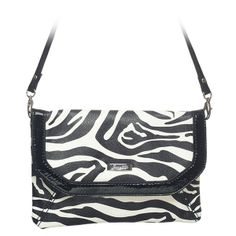 """Tess-Zebra Grace Adele Clutch    Chic and smart, Tess marries timeless styling with luxe materials. A detachable strap and interior pockets mean you'll use this clutch for just about everything.     Fits inside the exterior pocket on your favorite Grace Adele bag.           • Faux leather  • 9"""" L, 6"""" H  • 26.5"""" detachable strap  • 7"""" wrist wrap"""