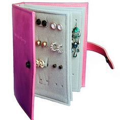 OMG YES. I've been looking for DIY jewelry storage ideas!! Little Earring Book :: Leather cover, cardboard covered with felt or fabric for the pages, punch the pages with mini hold puncher, stitch a strap on the cover (a button fastener would be just as cute & easier)... and viola! Beautiful idea!