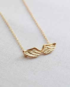 Angel Wings Necklace in silver or gold by Olive Yew. Petite wings charm is the perfect gift for your little angel.