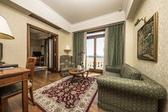 Inside the hotel's byzantine-inspired exterior, hides a neoclassical heart: wood paneling, marble inlay and wooden floors, plush carpets, cabriole and chesterfield sofas, ornate furniture, luxurious details, generous amenities and, of course, breathtaking views