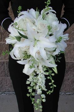 Gorgeous white lilies bouquet for the bride! Teardrop shape of white lilies, white roses and larkspur for the bride White Lilies are a stunning statement in this teardrop style bouquet Wedding flowers decoration bouquets ideas for 2019 Lily Bouquet Wedding, Cascading Wedding Bouquets, Wedding Flower Guide, Cascade Bouquet, Bride Bouquets, Bridal Flowers, Floral Wedding, Trendy Wedding, White Lily Bouquet
