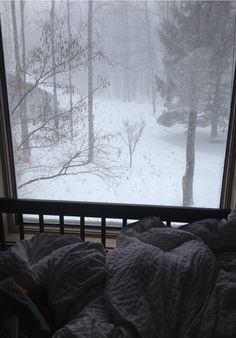 Wrapped in your duvet looking out at the snow - heaven! (if you don't have to go anywhere)