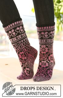 "Ring of Roses Socks - DROPS socks with pattern in ""Delight"" and ""Fabel"". - Free pattern by DROPS Design Drops Design, Knitted Slippers, Knitted Poncho, Knit Shoes, Sock Shoes, Fair Isle Knitting, Knitting Socks, Knitting Patterns Free, Free Knitting"