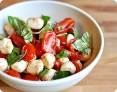 INGREDIENTS:  2 pints cherry or grape tomatoes, quartered  1/2 teaspoon sugar  Salt and pepper  1 tablespoon balsamic vinegar  1 garlic clove, minced  2 tablespoons extra-virgin olive oil  8 ounces fresh mozzarella cheese, cut into 1/2-inch cubes and patted dry  1 cup chopped fresh basil
