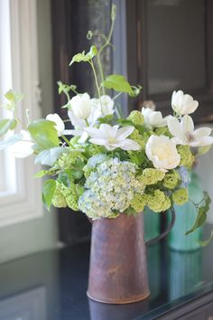 hydrangea, peonies, clematis in copper pitcher