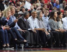 President Obama in the front row cheering on the Bulls.