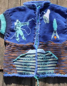 "My crocheted ""One Small Step, One Giant Leap"" sweater in honor of astronaut Neil Armstrong. This is the front."